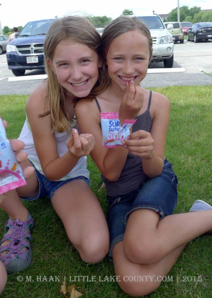 Kids enjoying Surf Sweets during the Little Lake County Playground Tour 2015
