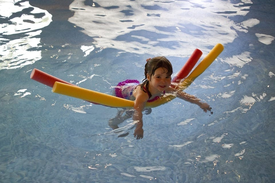 Girls swimming pool noodle